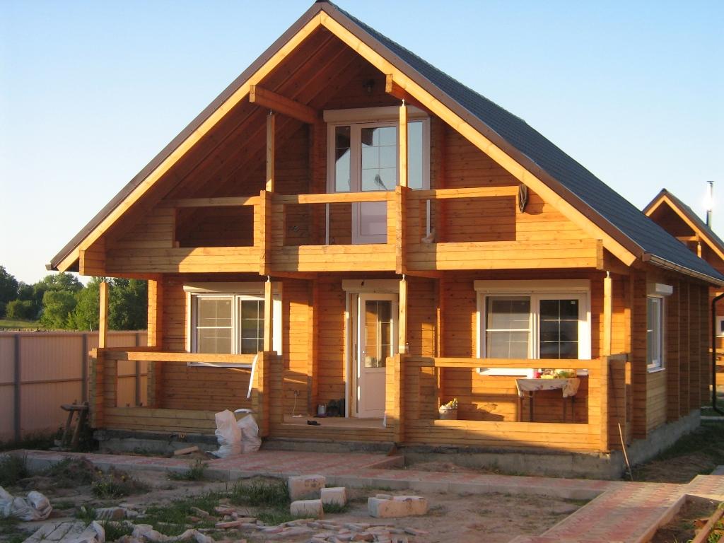 Дома с двускатной крышей фото